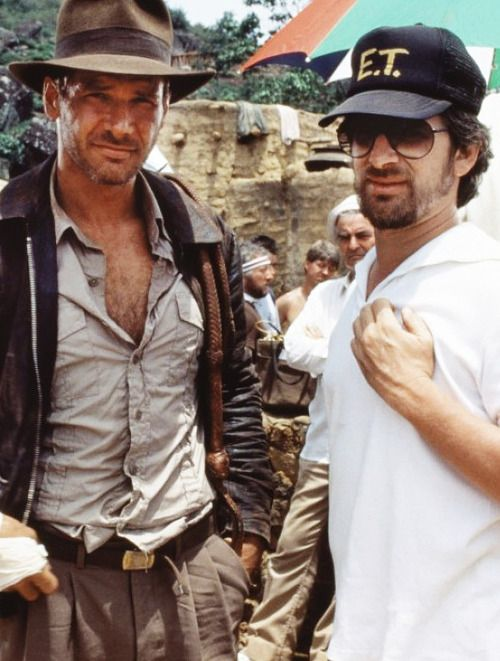 "Harrison Ford and Steven Spielberg on-set of ""Indiana Jones and the Raiders of the Lost Ark."""