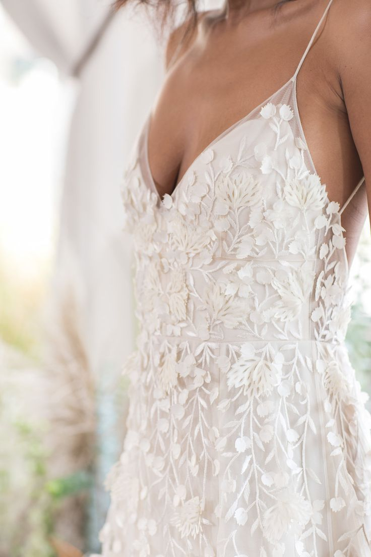 Delicate floral embroidered wedding gown with thin straps and v neck. #naturalwe…