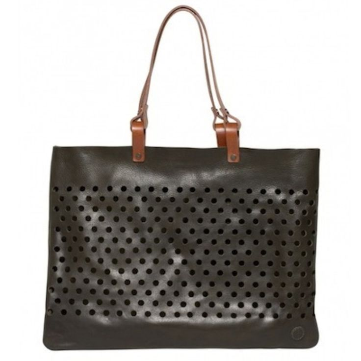 This Holey Tote is a great bag for carrying all her essentials. With its graphic punched out patterning and sturdy belting straps, this cowhide tote offers classic style with edge!