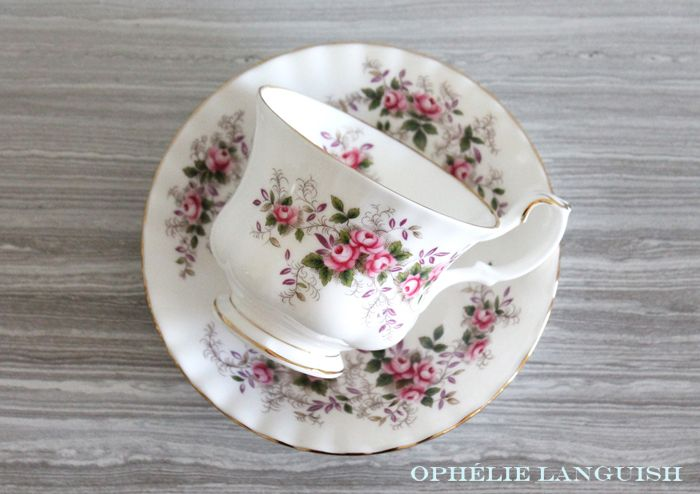 Elegant tea cup and saucer featuring a pink rose motif against a white background. Gold trim. Scalloped edges in the Montrose style. Footed tea cup. Very shabby chic. Multiple sets available.