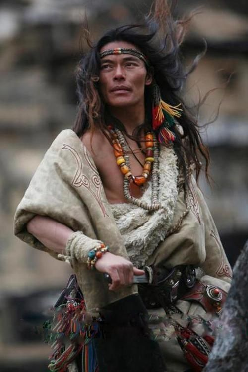 Tibetan man in traditional clothing and jewelry. It is traditional for Tibetan men to wear extravagant jewelry.
