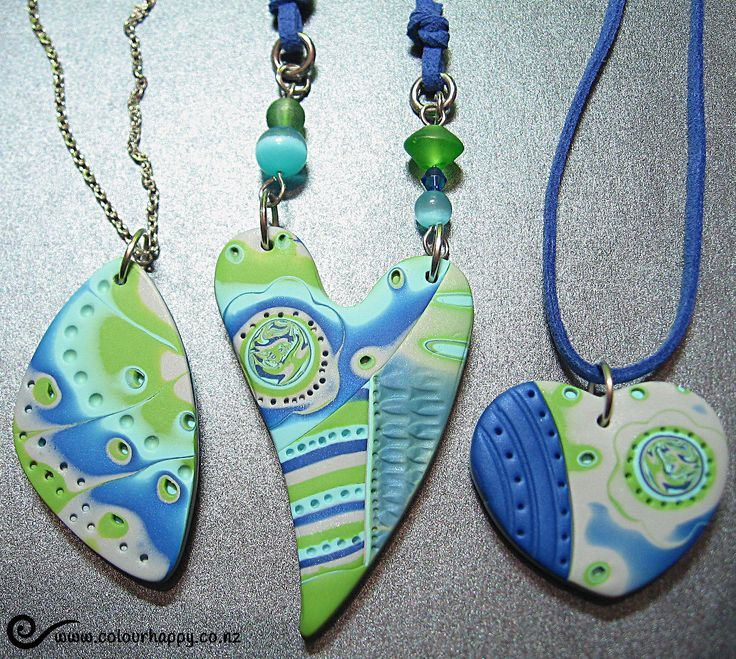 Having fun with Julie Picarello's imprint technique.  Polymer clay pendants by Colour Happy / Adele