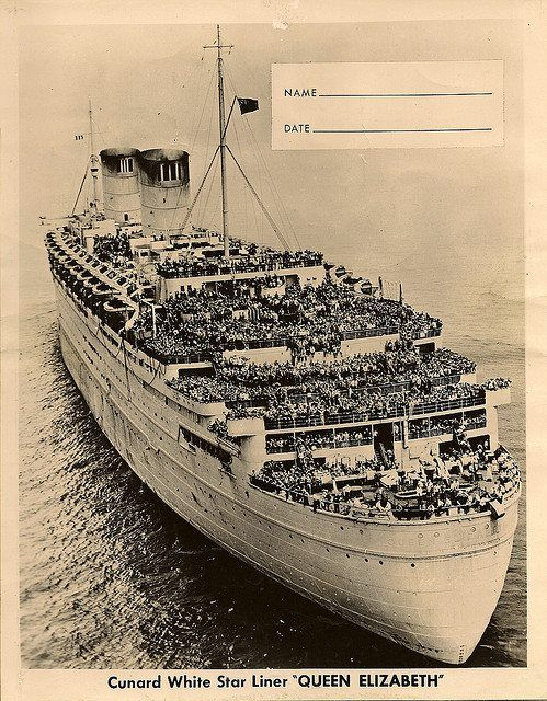 """The Liner, """" Queen Elizabeth, """" bringing American troops into NY Harbor, at the end of WWII."""