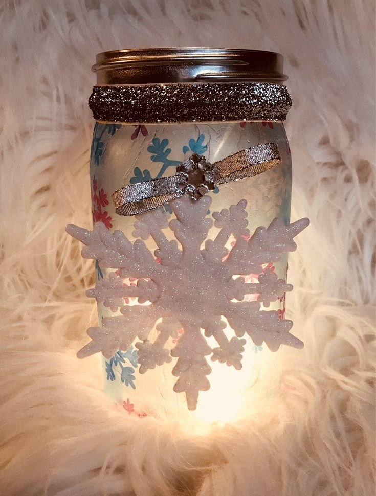 A personal favorite from my Etsy shop https://www.etsy.com/listing/559699292/snowflakemason-jar-lighted-mason-jars