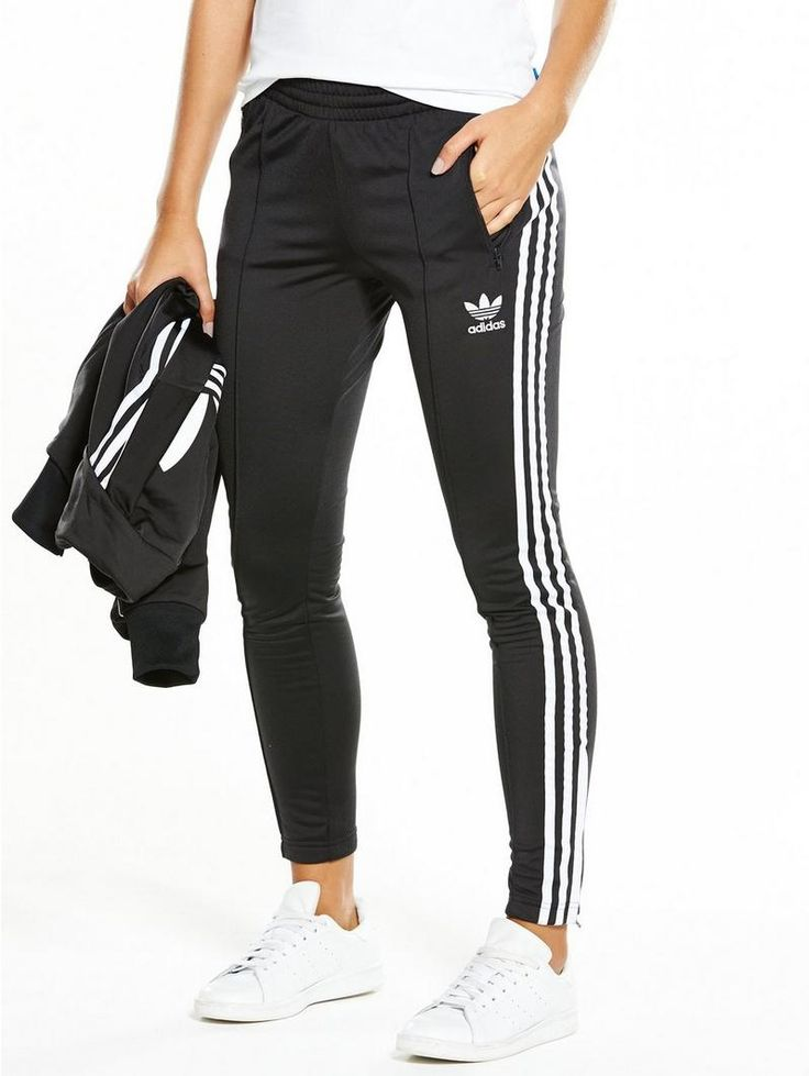 adidas Originals Superstar Track Pant With sporty styles still holding a place in this season's signature staples - these Superstar track pants by adidas Originals become a power player in your weekend wardrobe. In black, three stripes and a trefoil logo add an iconic edge to the tricot fabric and slim leg, and their mid rise is effortlessly flattering too. A matching track jacket is a must, as are bright white Stan Smiths and a Trefoil tee. Material Content: 100% rec polyesterWashing Ins...