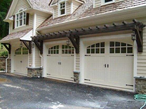 I love the shape of the windows on the garage doors. The hardware gives it a nice touch also! #CurbAppealContest @schlagelocks