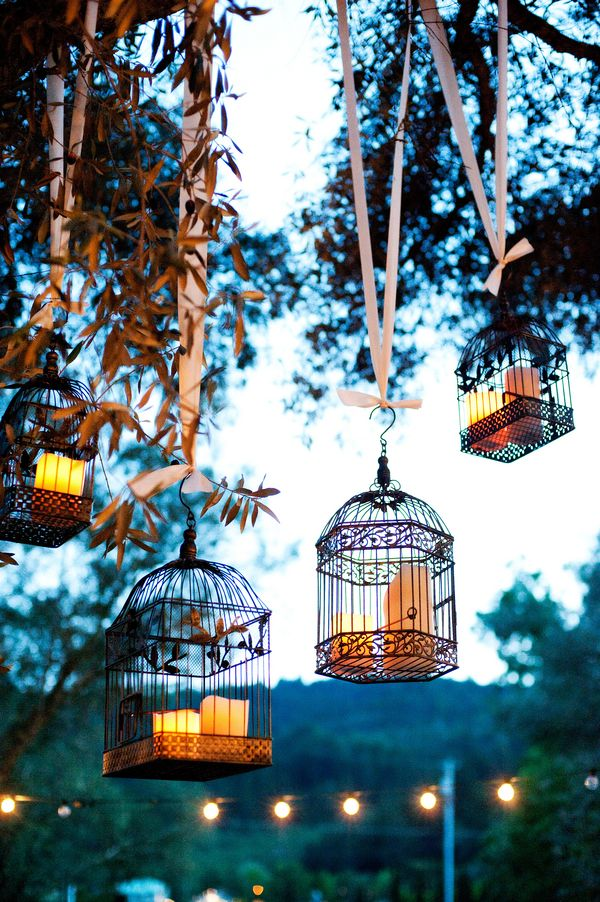 Candles in old bird cages for dusk atmosphere - Retro rustic wedding  |  brinton studios