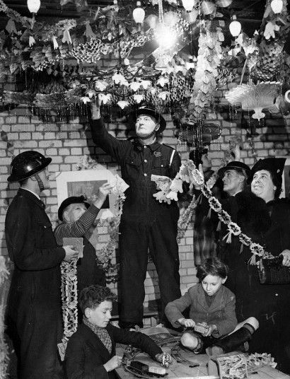 Wardens doing their best to keep up the Christmas cheer in a bunker beneath a central London cinema Picture: GETTY IMAGES