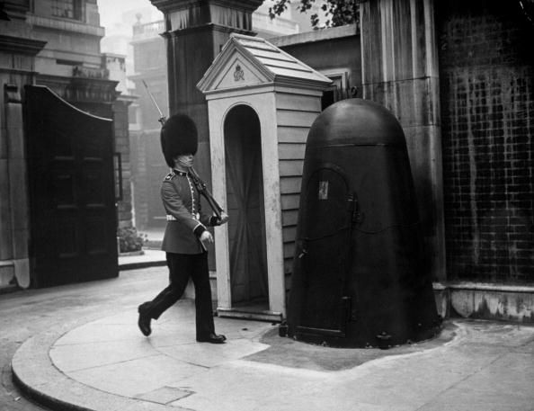 c1940: A guard on duty outside Marlborough House, London, with his individual air raid shelter next to his sentry box. Marlborough House was the London residence of George V's widow, the queen dowager, Mary of Teck. (Photo by Topical Press Agency/Getty Images)