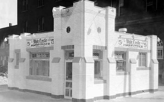 Image from https://chuckmanchicagonostalgia.files.wordpress.com/2011/10/photo-chicago-white-castle-hamburger-restaurant-a-1929-building-renovated-it-much-resembles-the-white-castle-at-79th-and-essex.jpg.