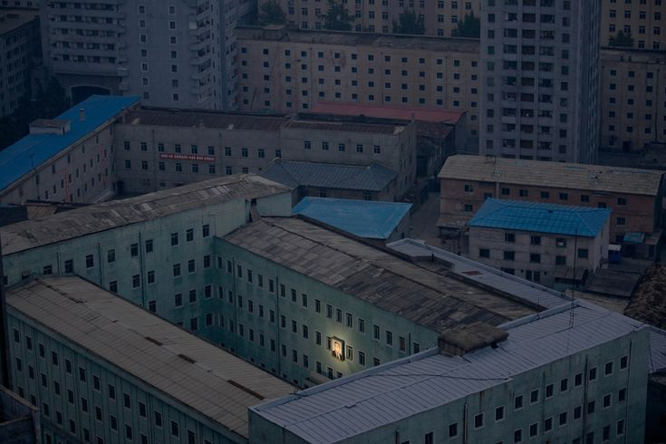 2012 World Press Photo Contest Winners - 1st Prize Daily Life Singles: A photograph of North Korea's founder, Kim II-sung, hangs on a building in the capital of Pyongyang, North Korea, Oct. 5, 2011. (Damir Sagolj/Reuters)
