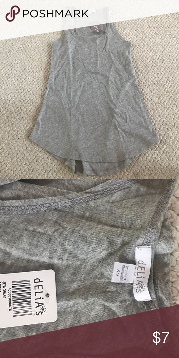 NWT Grey Tank top NWT grey tank top. Heather grey color. In perfect condition. can be worn to lounge around in or a night out delia's Tops Tank Tops