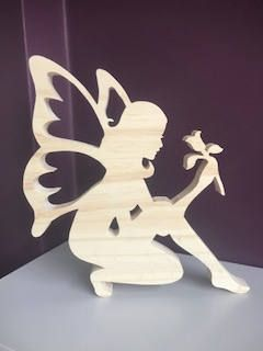 Beautifuly crafted natural wooden fairy holding a flower – Donna Bushkie
