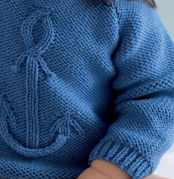 Un petit air de matelot plane sur le dressing de bébé. Modèle tricoté en 'Fil cabotine' coloris outremer au point jersey envers, point fantaisie et côtes 1/1. Modèle n°24 du catalogue N°122 : Layette, Printemps/été 2015