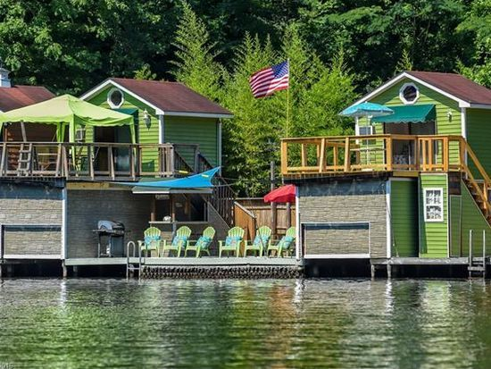 For sale: $172,300. Two Lake Lanier boat houses connected by a 27x24 deck.  Each boat house has a boat slip on the lower level, upper level has a 10x11 room plus a 12x16 deck.  Both upper decks have been recently replaced.  One house has a small kitchen with sink (non potable water), refrigerator, microwave & sleeper couch.  Other house has 2 beds & compost toilet.  Both have window A/C units.  One has a 6,000 pound boat lift.  Most furnishings included to make it ready to enjoy ...