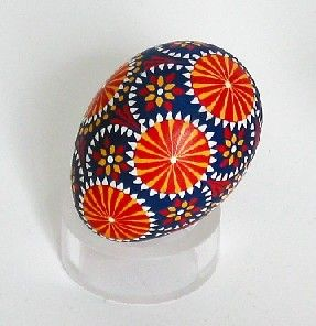 An egg decorated in the Sorbian manner, using a trimmed goose quill to apply wax.