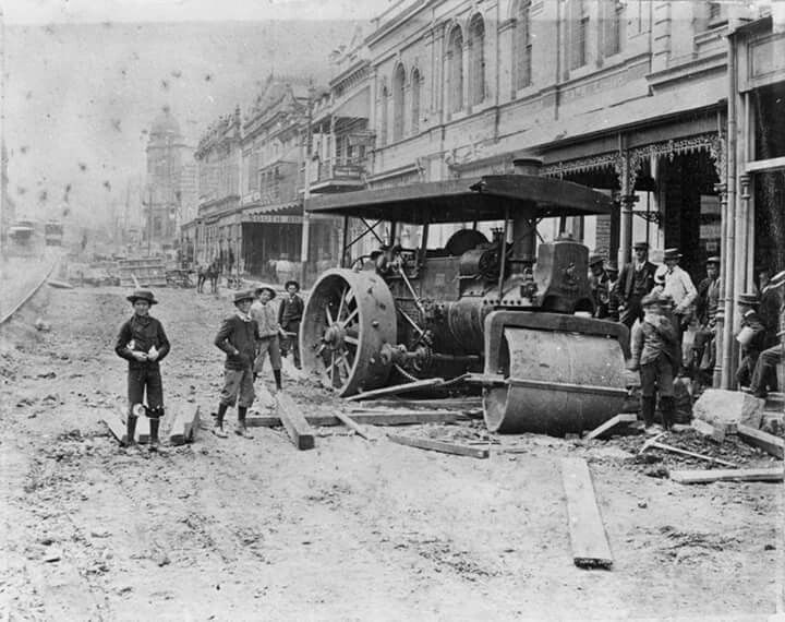 Steam roller bogged in mud while laying wooden paving blocks in Queen St in Brisbane in 1898.