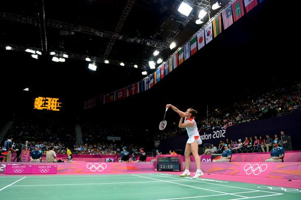 Susan Egelstaff of Great Britain serves the birdie to Maja Tvrdy of Slovenia during their Women's Singles Badminton on Day 1 of the London 2012 Olympic Games at Wembley Arena on July 28, 2012 in London, England.