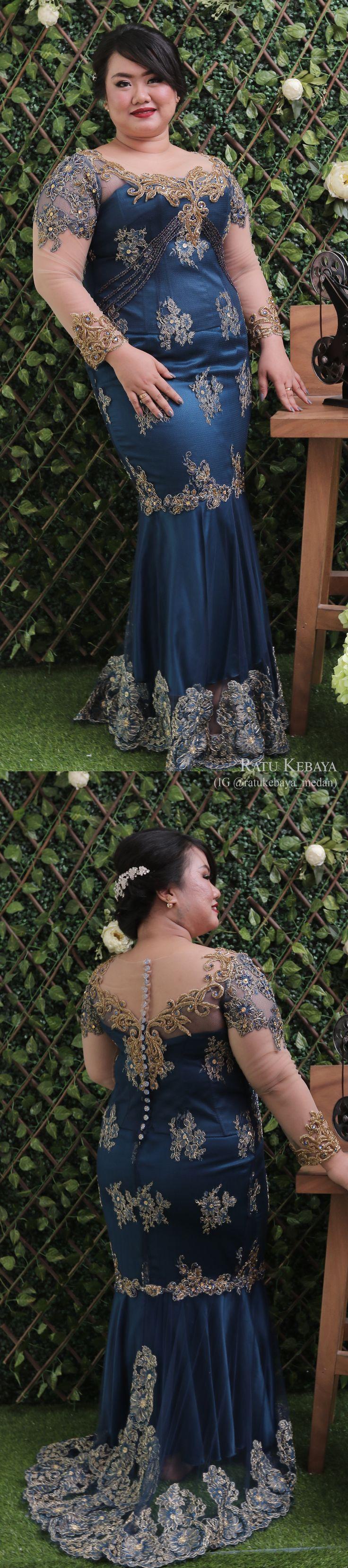 Gaun renda dengan detail rok duyung (IG @ratukebaya_medean