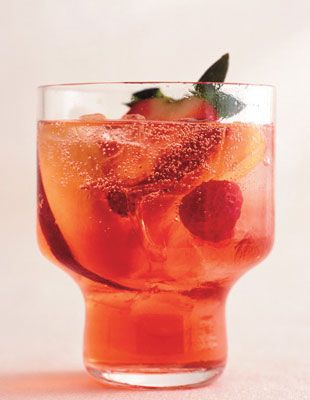 negroni punch: 4 cups assorted fresh fruit (such as berries, pitted cherries, and pitted sliced apricots and peaches) / 2 to 4 tablespoons sugar (optional) / 1 cup Campari / 1 cup sweet vermouth / 1 cup gin / 2 750-ml bottles chilled Prosecco / ice cubes