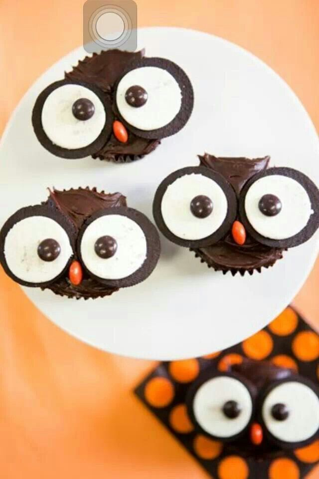 So easy! Chocolate cup cakes, oreo's and m & m's for the eyes and an orange m & m for the nose. Perfect for fall!