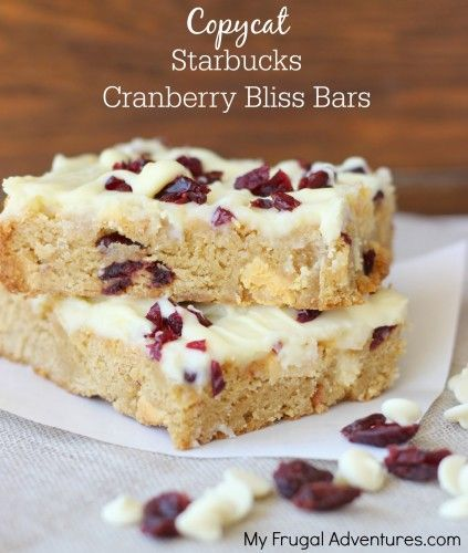 Copycat Starbucks Cranberry Bliss Bars Recipe.  Trust me these are absolutely delicious and a perfect homemade gift for the holidays!  Tart cranberry and orange, rich white chocolate, cream cheese and a gooey cake bar.  Perfect!