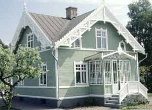 Small picture I'm sorry to say... But lovely old Swedish house in old soft green and white, newly painted