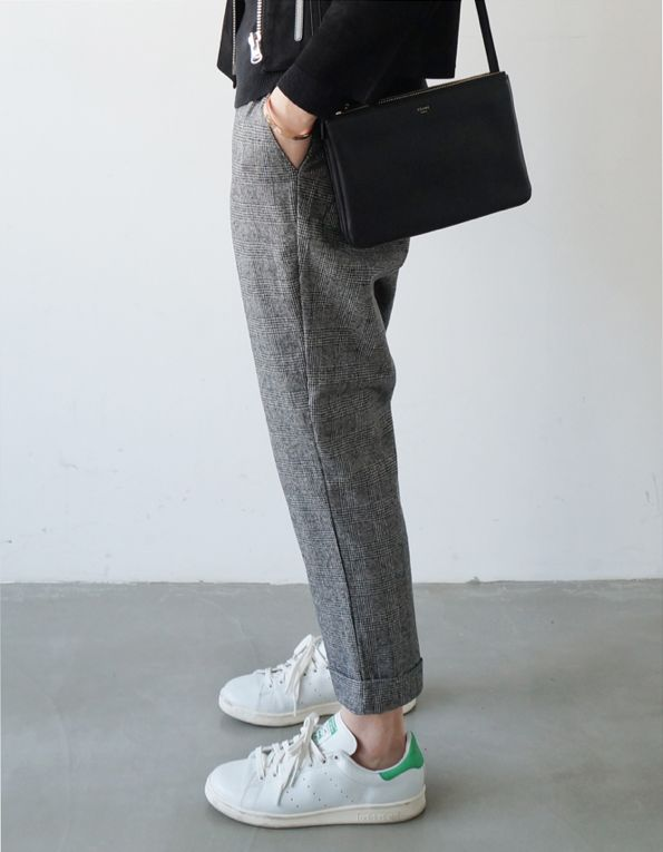 White canvas shoes and grey suit trousers