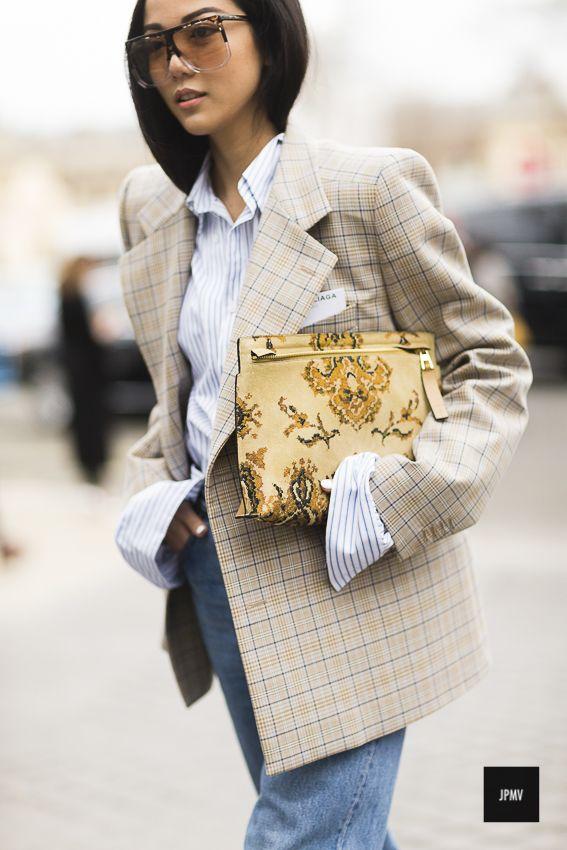 Streetstyle of Yoyo Cao wearing a Balenciaga oversized jacket and a Loewe clutch during Paris Fashion Week Fall Winter 2017