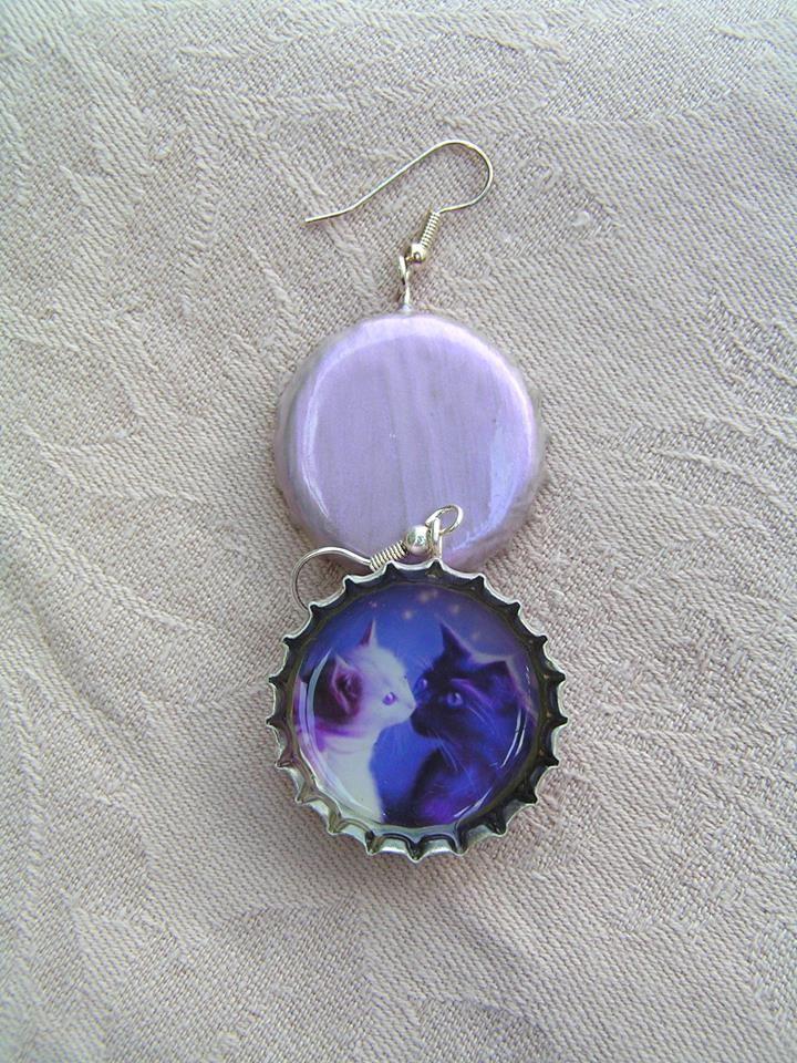 Cat romance earrings  in pearlescent, light purple colored bottle caps.