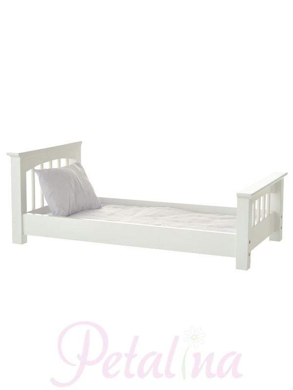 A white painted doll sized bed from laurent Doll inspired by the simple, functional lines of a classic craftsman style. The bed is made from wood in China having been designed in the US. A white cotton mattress and pillow are included and bedlinen can be ordered separately in various colours.