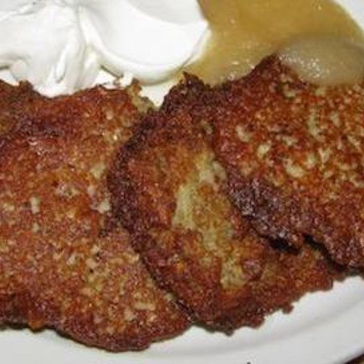 """My grandmother taught me how to make these. I have to make extra cause I find myself eating them as I'm cooking them.  The key to crispy edges is to make sure you drain the excess water from the potato and onion mixture.   It takes a bit of work if you are using a regular hand grater but if your food processor or blender has """"grate"""" on it, it will go a lot faster."""