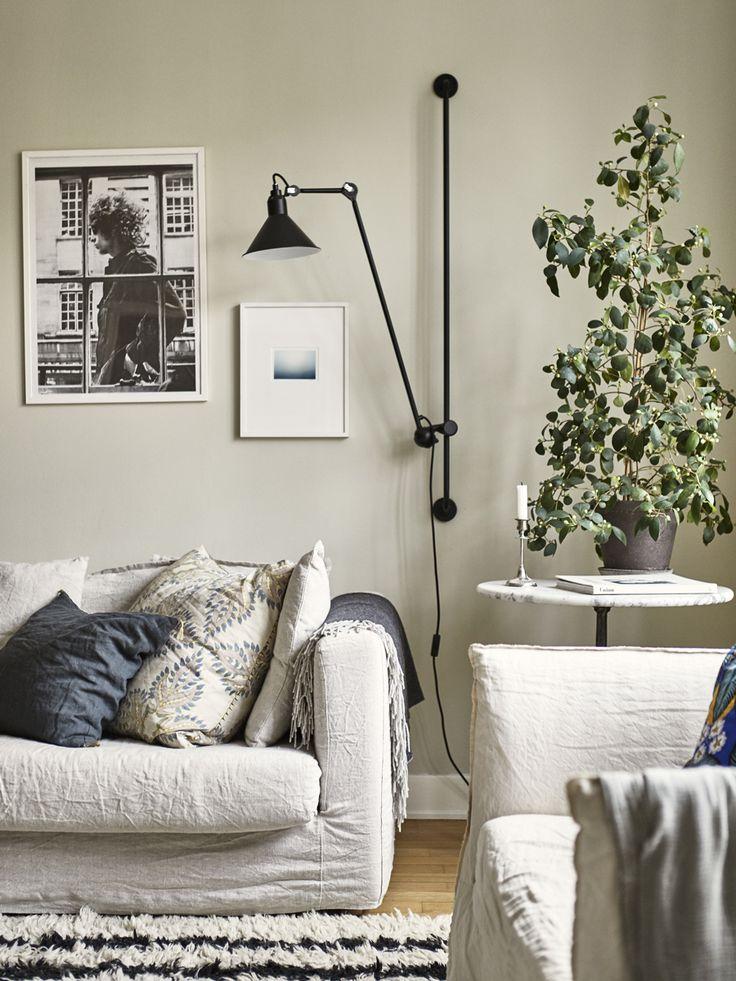 sofa and art wall at Johanna Bradfords home.