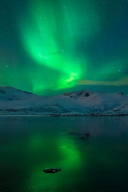 Aurora borealis reflected in a lake in Kiruna, Sweden