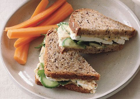Hummus and Feta Sandwiches on Whole Grain Bread  These sandwiches are portable and keep well in a lunch box. The hummus should be thick for the sandwiches, but if you want to enjoy the leftovers as a dip, thin slightly with a little extra olive oil.