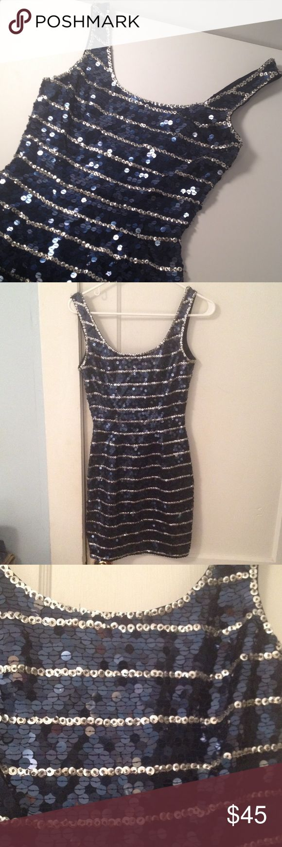 Niteline Della Roufogali Sequin Party Dress Niteline Della Roufogali Sequin Party Strapless Dress. Size 2. Sequins are mostly blue with some silver (the horizontal lines). Composition is 100% polyester. The perfect holiday dress or wear it for New Years Eve! Niteline Della Roufogali  Dresses