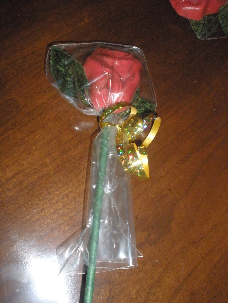 Long-stem red rose.  I use red, pink, dark or white chocolate.  I wire the leaves and wrap the stems with floral tape. Sometimes add sparkle, and wrap in clear bags with curled glitter ribbons.
