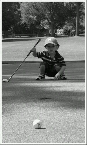 Reading his putt Little Champion Le Kids Club Lavagnac Country Club http://www.lavagnac-countryclub.com/accueil/