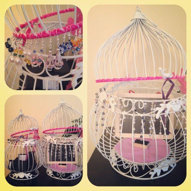 A creative jewellery display using a bird cage