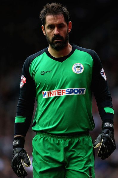 Scott Carson Photos Photos - Scott Carson of Wigan Athletic in action during the Sky Bet Championship match between Derby County and Wigan Athletic at the iPro Stadium on October 25, 2014 in Derby, England. - Derby County v Wigan Athletic - Sky Bet Championship