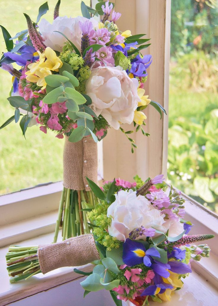 Florissimo, Shropshire - Flowers for weddings, events and businesses | Colourful late spring hand-tied bridal and flowergirl's bouquets of pink peony, yellow freesia, purple iris, pink sweet william, red tulip, pink veronica, mauve stock and lavender. For retro wedding glamour!