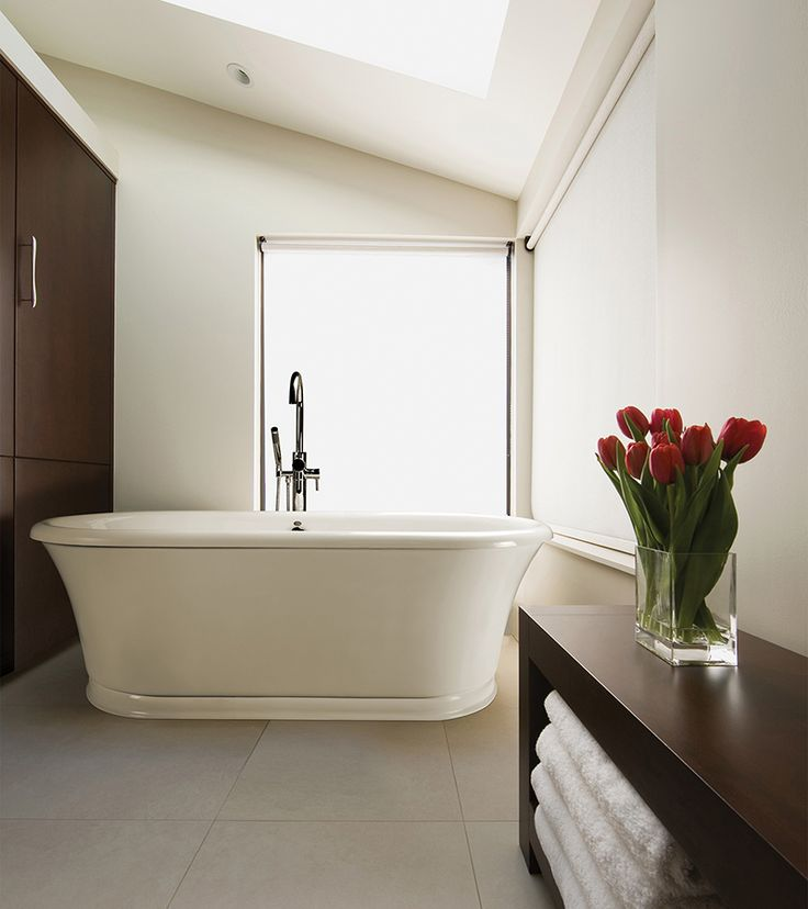 Freestanding tub in a fresh take on classic design features an integrated pedestal see the drop in tub version laney