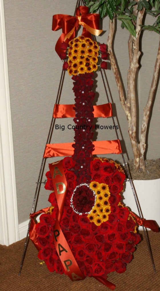 We made this Flower Guitar for a funeral yesterday in Abilene Texas.  If you like it, please share it, we appreciate it. It would be cool to have a flower quilt for grandma's funeral. She sold and made hundreds of quilts in her lifetime.