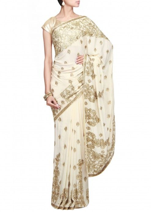 Cream saree embellished in kardana and zari only on Kalki