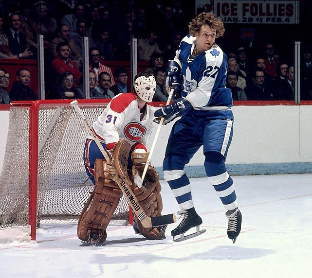 The Maple Leafs' Darryl Sittler screens Canadiens goalie Michel Larocque in the late 1970s. [Photo: Denis Brodeur (1930-2013) / NHLI via Getty Images]