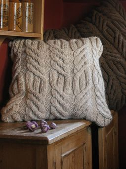 Rustic with a great cable. Rutland Cushion, free pattern from Rowan
