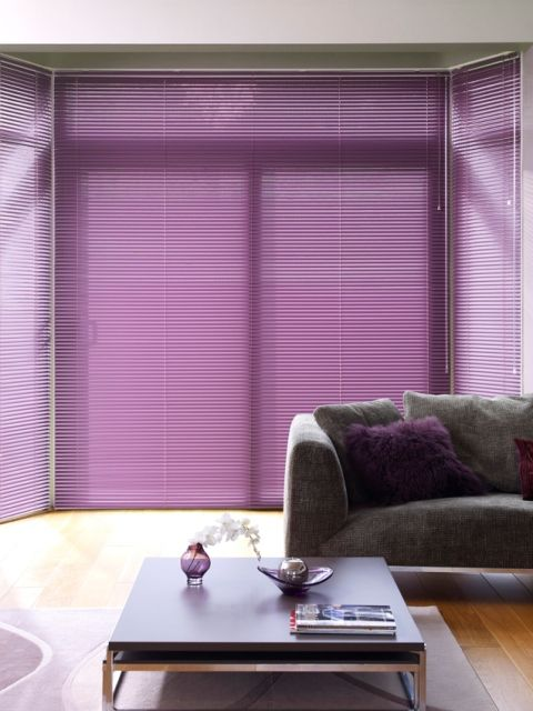 Wow! Bright purple Venetian blinds are certainly a bold choice but you won't regret it when you've created a glamorous addition to your home.