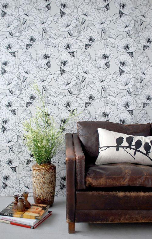 Florence Broadhurst wallpaper with a well worn Borge sofa