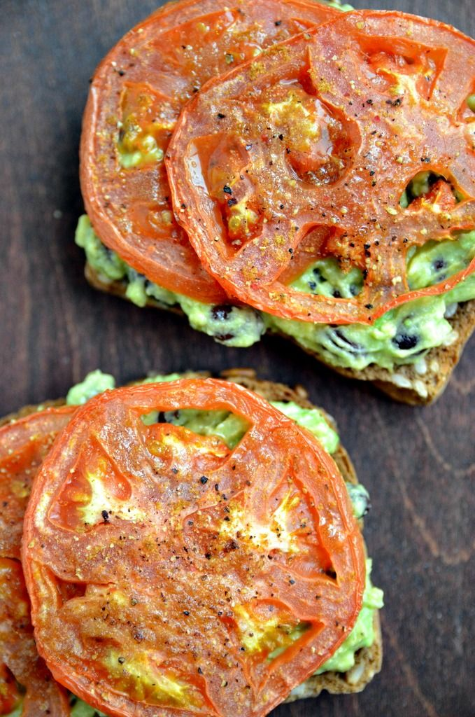 Smashed Avocado, Black Bean, Roasted Tomato Toasts .......... Seeded bread is toasted and slathered with freshly smashed avocado and black beans, and the loveliness really comes together with the addition of cumin-dusted roasted tomatoes and a sprinkling of pepitas. The combination creates a crunchy, creamy, and flavorful sandwich that is full of healthy nutrients........ Kur <3