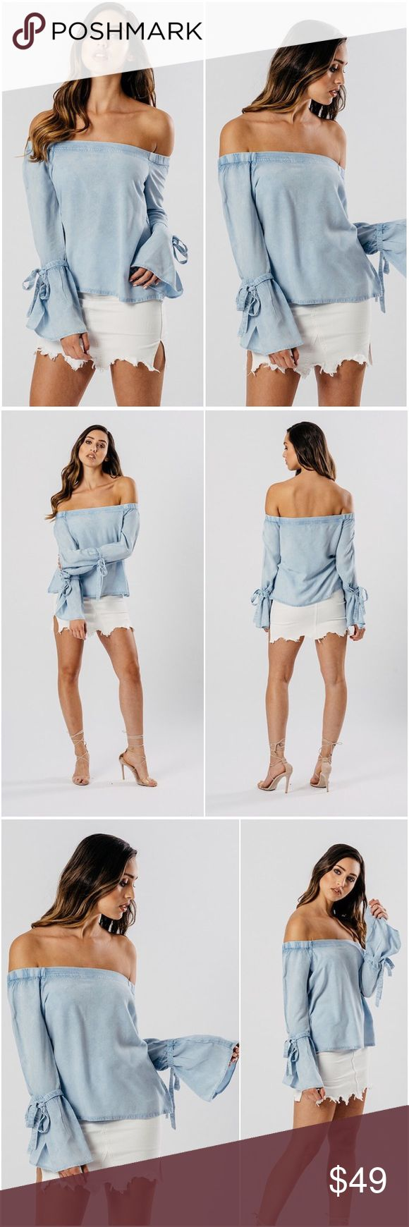 🆕Shae Light Wash Chambray Bardot Top **PLEASE NOTE THIS IS A NEWLY ADDED ITEM TO OUR SPRING/SUMMER COLLECTION AND ALL ORDERS SHIP WITHIN 3-5 BUSINESS DAYS**  Sweet ties adorn the sleeves of this breezy, off the shoulder top made with a light-wash chambray.  Viscose Fabric Construction Off The Shoulder Fit  Multiple sizes available - Limited quantity A Mermaid's Epiphany Tops Blouses